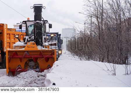 Norilsk, Russia - March 23, 2020: Snow Removal Machine, Road Cleaning Vehicle, Snow Plow Doing Snow