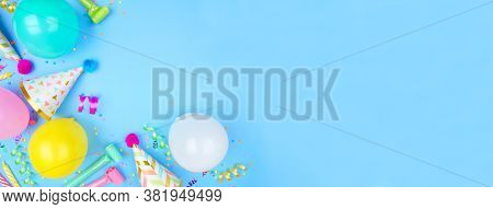 Birthday Party Banner With Corner Border On A Blue Background. Overhead View With Confetti, Balloons