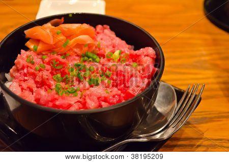 Toro Donburi in the black bowl.