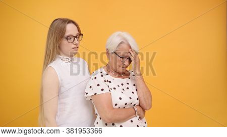 Young Woman Calming Down Senior Lady After Bad News. Family Love And Care Concept. High Quality Phot