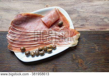 Balkan Cuisine . Slices Of Prsut: Dry-cured Ham,  Balkan Version Of Prosciutto. Rustic Background. C