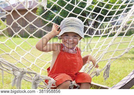 Cute Child Is Sitting In Hammock. Male Boy Playing In Hammock, Happy Child, Active Child.