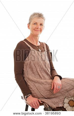 Portrait Of Smiling Older Woman Sitting Sideways