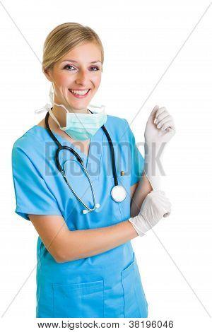 Woman In Doctor Uniform Wearing Latex Gloves
