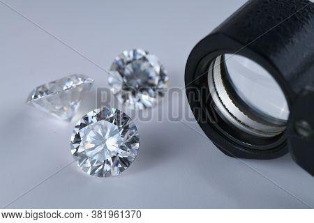 Diamond Gemstone. Precious Loose Diamonds And Jewelry Loupe