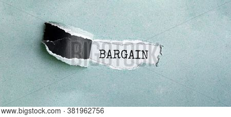 Bargain Appearing Behind Torn Brown Paper, Business Concept