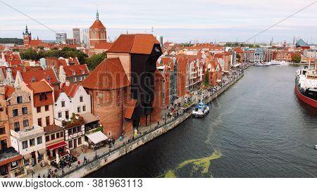 Gdansk, Poland 09.15.2019 Crane - Motlawa River - Historic Medieval Building. Aerial Photo