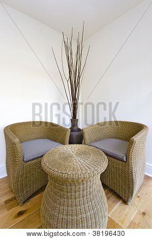 Living room detail with a rattan armchairs and table