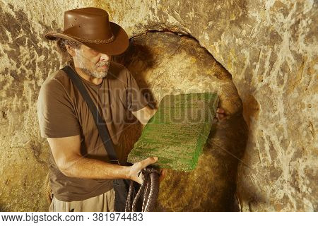 Adventurer In Ancient Cave On Trace Of Mysterious Emerald Tablet Finding Famous Artifact