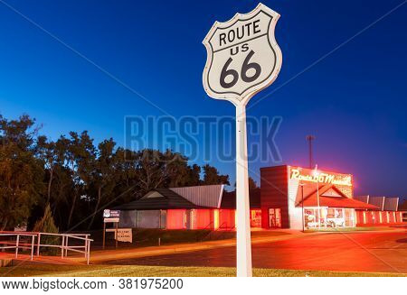 Clinton Usa September 10 2015; Route 66 Museum Retro Style Bright Red And Orange Neon Sign Over Buil
