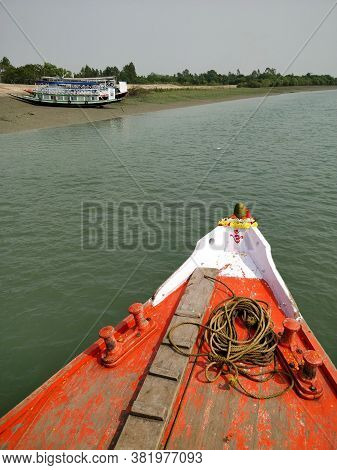The Prow Of A Bright Red Fishing And Tourist Boat Sailing On The Bay Of Bengal