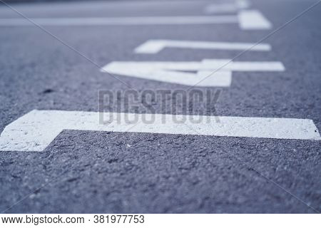 Close-up Of White Paint Markings On Parking Lot.empty Car Parking, Car Parking Lot With White Mark,