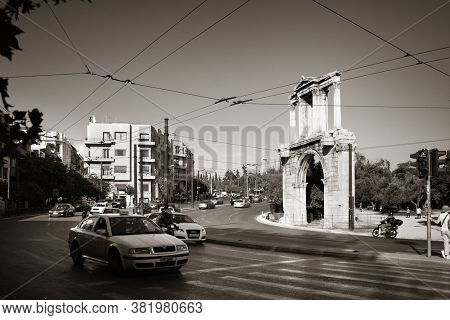 ATHENS - SEP 26: Street view with Arch of Hadrian on September 26, 2016 in Athens, Greece. Athens is one of the world's oldest cities with the history of 3400 years.