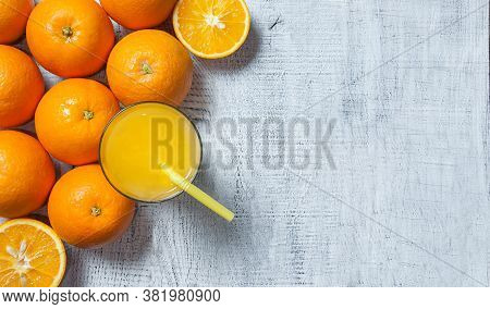 Freshly Squeezed Orange Juice Cold Drink In Glass With Orange Fruits On Wooden Background, Bitter Se