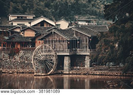 FUJIAN, CHINA – MARCH 2, 2018: Yunshuiyao old town by the river with watermill in Fujian, China.
