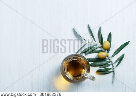 Glass Bottle Of Homemade Olive Oil And Olive Tree Branch, Raw Turkish Green Olive Seeds And Leaves O