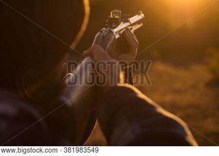 Hunter With Shotgun Gun On Hunt. Close Up Hunter Hunting. Hunter Man With Shotgun Gun On Hunt. Poach