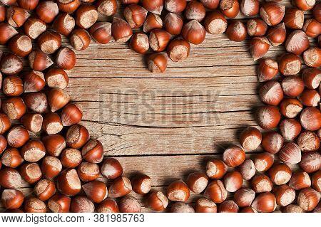 Hazelnuts Heart Shape, Filbert On Rustic Wooden Table. Heap Or Stack Of Hazelnuts. Hazelnut Backgrou