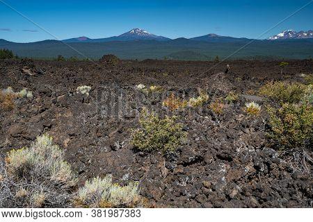 The Barren Volcanic Landscape Of Newberry Volcano National Monument In Oregon