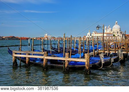 Gondolas Moored Near San Marco Square In Venice, Italy. Venice Is Situated Across A Group Of 117 Sma