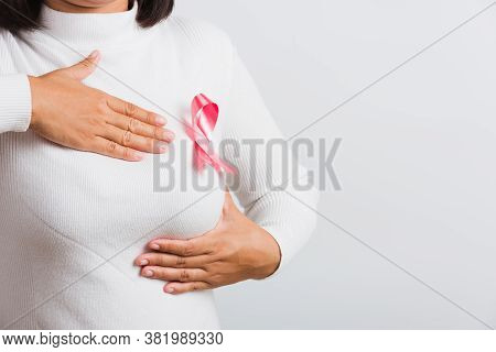 Breast Cancer Awareness Healthcare And Medicine Concept. Close Up Asian Woman Wear T-shirt She Have