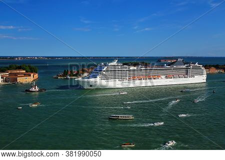 Cruise Ship Moving Through San Marco Canal In Venice, Italy. Venice Is Situated Across A Group Of 11