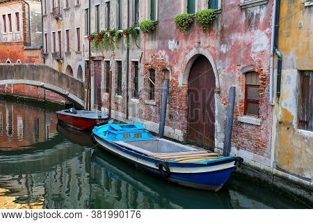 Boats Moored In A Narrow Canal In Venice, Italy. Venice Is Situated Across A Group Of 117 Small Isla
