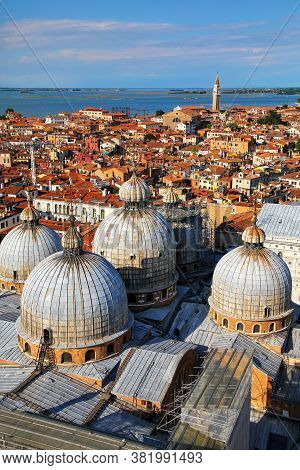 View Of The Domes Of St Mark's Basilica In Venice, Italy. It Is The Most Famous Of The  Churches In