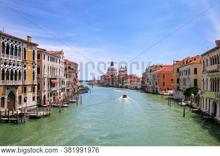 View Of Grand Canal And Basilica Di Santa Maria Della Salute In Venice, Italy. Venice Is Situated Ac