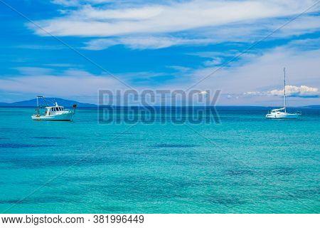 Beautiful Seascape On Adriatic Seascape Paradise On The Island Of Pag In Croatia. Boats On Horizon.