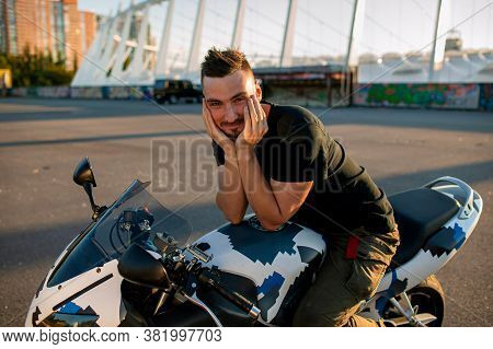 Biker Man And Motorcycle With City Background, Rider Moto Trip On The Street