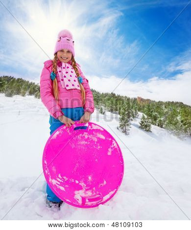 Happy Girl In Pink Holding Sled
