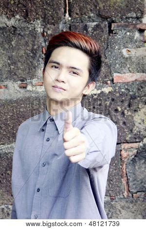 Filipino Man Making A Thumbs Up Sign