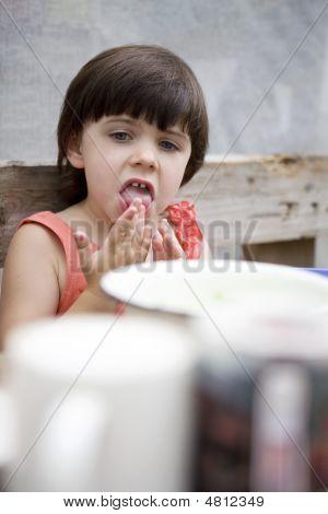 Little Cute Girl Lick Her Fingers After Dinner