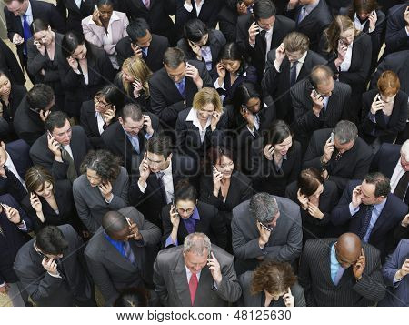 Elevated view of large group of business people using mobile phones