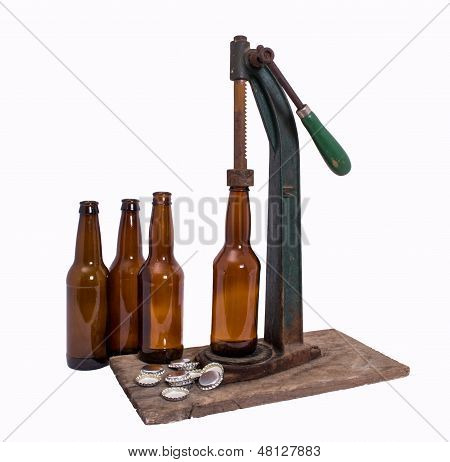 Beer bottles with caps and antique capper