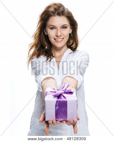Young beautiful woman gives gift in box isolated on white background