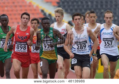 DONETSK, UKRAINE - JULY 11: Athletes compete in the heat on 1500 meters during 8th IAAF World Youth Championships in Donetsk, Ukraine on July 11, 2013