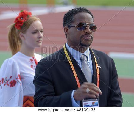 DONETSK, UKRAINE - JULY 11: IAAF Ambassador Ato Boldon hand over medals to athletes during 8th IAAF World Youth Championships in Donetsk, Ukraine on July 11, 2013