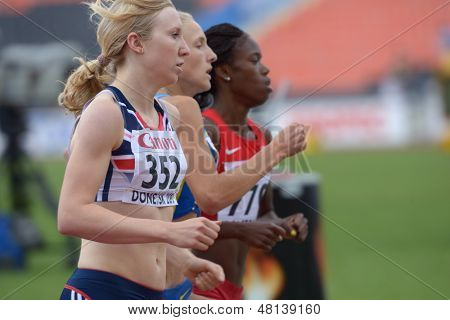 DONETSK, UKRAINE - JULY 11: Jenkinson, Great Britain (left), Duts, Ukraine (center), and Farrow, USA compete in 800 m during 8th IAAF World Youth Championships in Donetsk, Ukraine on July 11, 2013