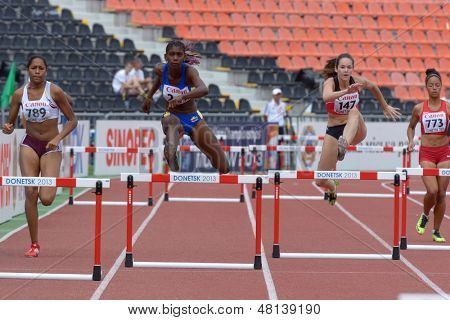 DONETSK, UKRAINE - JULY 11, 2013: Girls compete in semi-final of 400 m hurdles during 8th IAAF World Youth Championships in Donetsk, Ukraine on July 11, 2013