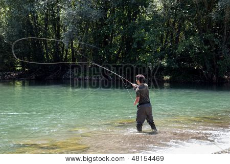 Fisherman Casting In Fly Fishing
