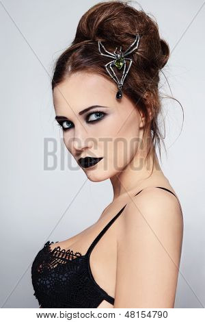 Portrait of young beautiful sexy woman with black lipstick and stylish hairdo