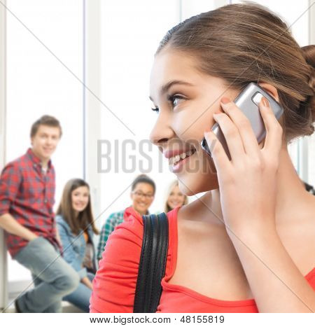 education and communication concept - student girl with cell phone at school