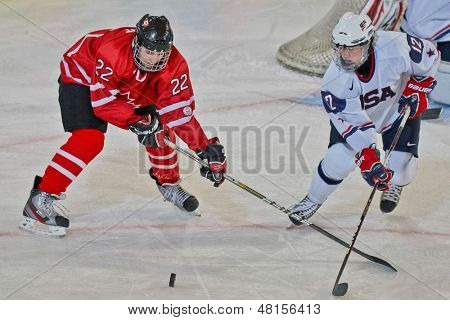 INNSBRUCK, AUSTRIA - JANUARY 15 Nicholas Hebert (CAN) and Jack Eichel (USA) fight for the puck as Canada beats the USA 5:1 in the men's ice hockey tournament on January 15, 2012 in Innsbruck, Austria.
