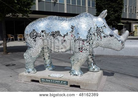 SOUTHAMPTON UK - 15 JULY 2013 - locally decorated Rhino sculptures on display in Southampton to raise awareness of the plight of Rhinos in the wild before charity auction - 15 July 2013 in Southampton