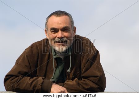 Elderly Man In Jacket
