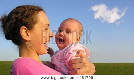 Faces Mother With Baby On Sunset With Cloud