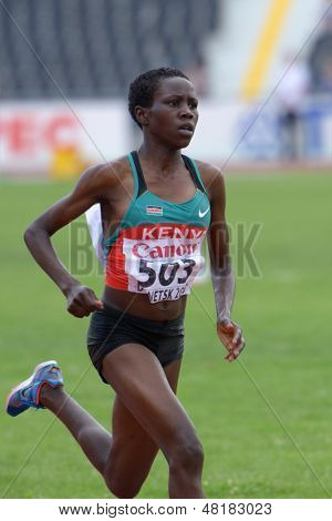 DONETSK, UKRAINE - JULY 14: Rosefline Chepngetich of Kenya fight for her gold medal in the final of 2000 m steeplechase during 8th IAAF World Youth Championships in Donetsk, Ukraine on July 14, 2013