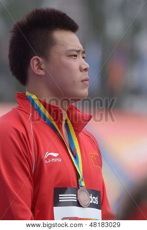 DONETSK, UKRAINE - JULY 14: Bronze medalist in discus throw Yulong Cheng of China on medal ceremony during 8th IAAF World Youth Championships in Donetsk, Ukraine on July 14, 2013